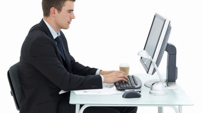 man-sitting-at-office-desk-working.jpg@protect035951803@crop658370c.jpg