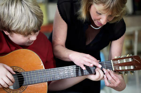 child-taking-music-lessons.jpg