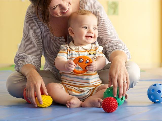infant-playing-with-mom1.jpg
